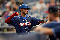 New Hampshire Fisher Cats shortstop Lourdes Gurriel Jr. (16) is congratulated by his teammates as he returns to the dugout after hitting a home run in the top of the ninth inning during a game against the Trenton Thunder on August 19, 2018 at ARM & HAMMER Park in Trenton, New Jersey.  New Hampshire defeated Trenton 12-1.  (Mike Janes/Four Seam Images)