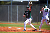 Dartmouth Big Green first baseman Michael Ketchmark (27) stretches for a throw as Mike Mioduszewski (15) runs through the bag during a game against the Eastern Michigan Eagles on February 25, 2017 at North Charlotte Regional Park in Port Charlotte, Florida.  Dartmouth defeated Eastern Michigan 8-4.  (Mike Janes/Four Seam Images)