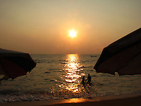 A couple on the Kovalam beach at sunset