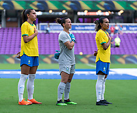 ORLANDO, FL - FEBRUARY 18: Aline #12 and Marta #10 of Brazil stand on the field before a game between Argentina and Brazil at Exploria Stadium on February 18, 2021 in Orlando, Florida.