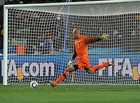 Goalkeeper Tim Howard launches the ball upfield off a goal kick. The United States came from a 2-0 halftime deficit to Slovenia to earn a 2-2 draw their second match of play in Group C of the 2010 FIFA World Cup.