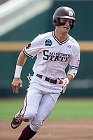 Mississippi State Bulldogs outfielder Jake Mangum (15) runs to third base during Game 8 of the NCAA College World Series against the Vanderbilt Commodores on June 19, 2019 at TD Ameritrade Park in Omaha, Nebraska. Vanderbilt defeated Mississippi State 6-3. (Andrew Woolley/Four Seam Images)