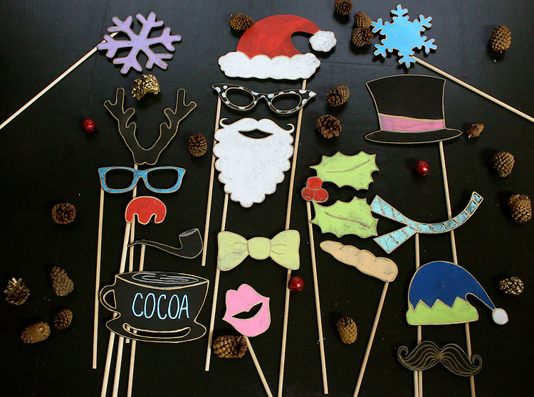 """Make your holiday pictures fun and full of personality with Tummy Tickles Designs Wooden Christmas Photo Booth Props.  These wooden chalkboard props are delivered undecorated and ready for you to personalize. They are durable yet lightweight props, which can be reused for future holiday celebrations.<br /> <br /> Material:<br /> 1/8"""" thick Wood<br /> <br /> Each prop is made with quality plywood and chalkboard paint finish.  <br /> <br /> You Will Receive:<br /> <br /> 18 Bamboo rods 0.48cm x 30cm<br /> 1 Christmas mug<br /> 1 Snowman Scarf<br /> 1 Snowman Hat<br /> 1 Snowman Nose (Carrot)<br /> 1 Elf Hat<br /> 1 Bow Tie<br /> 2 Eye glasses<br /> 2 Snow Flakes<br /> 1 Reindeer Antlers<br /> 1 Reindeer Nose<br /> 1 Santa Claus Hat<br /> 1 Santa Claus Beard<br /> 1 Pipe<br /> 1 Holly leaves<br /> 1 Lip<br /> 1 Mustache"""