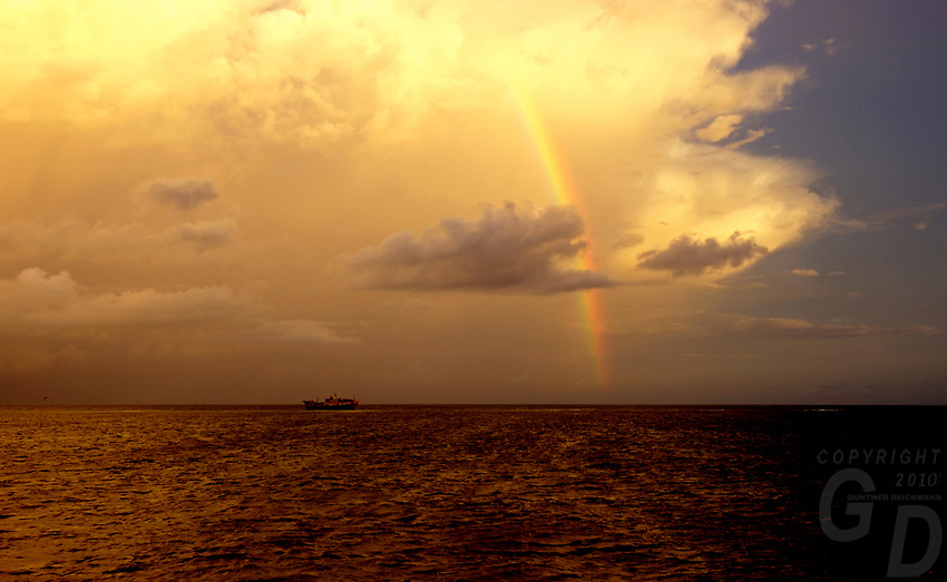 Images from the Book Journey Through Colour and Time, Rain storm over the Ocean near Pohnpei, Micronesia