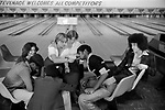 Group of teenagers hanging out in bowling alley Stevenage Hertfordshire 1970s England 1975 UK