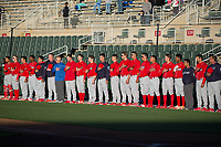 The Lakewood BlueClaws stand for the National Anthem prior to the game against the Kannapolis Intimidators at Kannapolis Intimidators Stadium on April 7, 2017 in Kannapolis, North Carolina.  The BlueClaws defeated the Intimidators 6-4.  (Brian Westerholt/Four Seam Images)