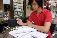 Montreal (Qc) CANADA ,August 2008 -<br /> Model Released photo -<br /> <br /> 17 year old male asian (Vietnamese) teen studying  doing homework outside  a coffee shop, in Old-Montreal.<br /> <br /> photo : (c) images Distribution