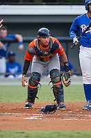 Greeneville Astros catcher Gabriel Bracamonte (18) checks the runner at first base after blocking a pitch in the dirt during the game against the Burlington Royals at Burlington Athletic Park on August 29, 2015 in Burlington, North Carolina.  The Royals defeated the Astros 3-1. (Brian Westerholt/Four Seam Images)