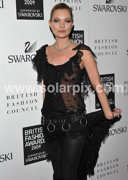**ALL ROUND PICTURES FROM SOLARPIX.COM**.**WORLDWIDE SYNDICATION RIGHTS**.Press room and backstage at the British Fashion Awards 2009.  Held at the Royal Courts of Justice, Strand, London, UK.  9 December 2009..This pic: Kate Moss..JOB REF: 10368 SSD     DATE: 09_12_2009.**MUST CREDIT SOLARPIX.COM OR DOUBLE FEE WILL BE CHARGED**.**MUST NOTIFY SOLARPIX OF ONLINE USAGE**.**CALL US ON: +34 952 811 768 or LOW RATE FROM UK 0844 617 7637**
