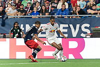 FOXBOROUGH, MA - JUNE 23: Fabio Gomes #9 of New York Red Bulls brings the ball forward as Brando Bye #15 of New England Revolution closes during a game between New York Red Bulls and New England Revolution at Gillette Stadium on June 23, 2021 in Foxborough, Massachusetts.