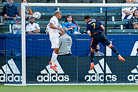 CARSON, CA - JUNE 19: Cristian Roldan #7 of the Seattle Sounders FC and Julian Araujo #2 of the Los Angeles Galaxy battle during a game between Seattle Sounders FC and Los Angeles Galaxy at Dignity Health Sports Park on June 19, 2021 in Carson, California.