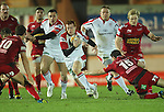 Ulster full back Peter Nelson causes problems for the Scarlets defence as he skips past Dan Newton..Celtic League.Scarlets v Ulster.Parc y Scarlets.02.12.12..©Steve Pope