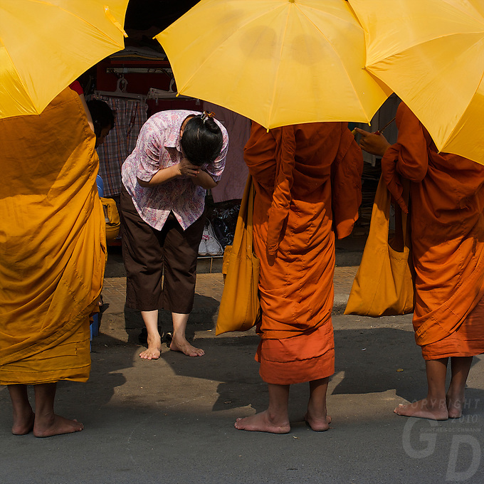 Buddhist Monks collecting their Alms at the Russian Market Phnom Penh, Cambodia