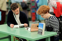 Pictured: People read books in the festival book store Monday 30 May 2016<br /> Re: Hay Festival, Hay on Wye, Wales, UK