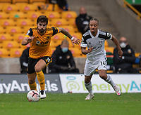 Wolverhampton Wanderers' Ruben Neves (left) under pressure from Fulham's Bobby Reid (right) <br /> <br /> Photographer David Horton/CameraSport<br /> <br /> The Premier League - Wolverhampton Wanderers v Fulham - Sunday 4th October 2020 - Molineux Stadium - Wolverhampton<br /> <br /> World Copyright © 2020 CameraSport. All rights reserved. 43 Linden Ave. Countesthorpe. Leicester. England. LE8 5PG - Tel: +44 (0) 116 277 4147 - admin@camerasport.com - www.camerasport.com