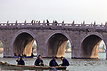 People On Boat with Bridge In Background