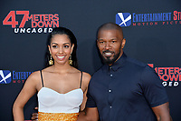 "LOS ANGELES, USA. August 14, 2019: Corinne Foxx & Jamie Foxx at the premiere of ""47 Meters Down: Uncaged"" at the Regency Village Theatre.<br /> Picture: Paul Smith/Featureflash"