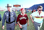 """Bobby Bowden grimices as he leaves the field with his long time Florida Highway Patrol security and Sports Information director Wayne Hogan after Miami defeated the Seminoles 17-16 in the 1991 game in Tallahassee that came to be known as the """"Wide Right"""" game. (Mark Wallheiser/TallahasseeStock.com)"""