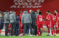 1st October 2020; Anfield, Liverpool, Merseyside, England; English Football League Cup, Carabao Cup, Liverpool versus Arsenal; Liverpool manager Jurgen Klopp and his coaching staff decide the order of the penalty takers for the shootout which will decide the tie