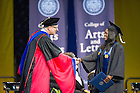 May 17, 2015;  Whitney Holloway shakes hands with College of Arts & Letters dean John McGreevy after receiving her diploma at the Arts & Letters diploma ceremony in the Purcell Pavilion. (Photo by Barbara Johnston/University of Notre Dame)