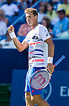 Vasek Pospisil (CAN) fell to Roger Federer (SUI) at the Western & Southern Open in a three set match by 76(4) 57 62 in Mason, OH on August 13, 2014.