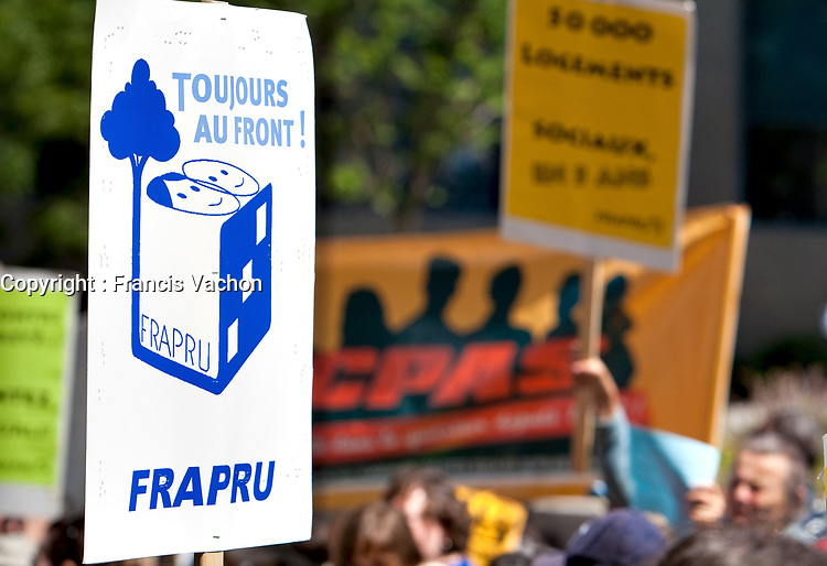 A FRAPRU sign is seen during an anti-poverty protest in front of the Congress Center in Quebec city June 15, 2009. The FRAPRU, FRont d'Action Populaire en Reamenagement Urbain, was created in 1978 to fight for poor people and the cration of social housing.<br /> <br /> PHOTO :  Francis Vachon - Agence Quebec Presse