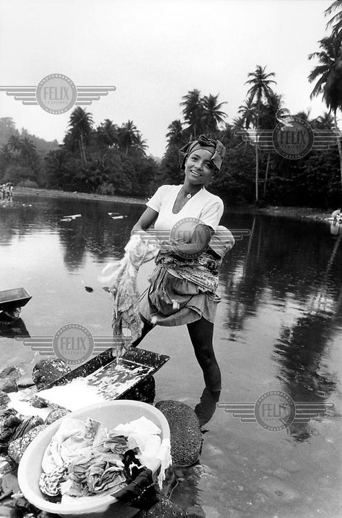©Martin Adler/Panos Pictures.SAO TOME..Praia das Pombas, South of Sao Tome town.Washing clothes