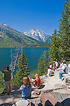 Visitors linger at Jenny Lake Viewpoint after conclusion of a ranger led talk.  Grand Teton National Park, United States, Wyoming.