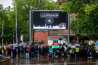 Monday 05 June 2017<br /> Pictured: The Crowd at the event and a screen above which reads ' Safwn Gyda Llundain' in welsh, translated it says' we stand with London' <br /> Re: A vigil has been held in Swansea City Centre to remember the victims of the recent terror attack in London. Stand up to Racism Swansea have organised the event alongside Swansea Coalition Against War and Swansea People's Assembly.
