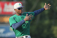 Beloit Snappers third baseman Miguel Sano #33 stretches prior to a game against the Kane County Cougars at Fifth Third Bank Ballpark on June 26, 2012 in Geneva, Illinois. Beloit defeated Kane County 8-0. (Brace Hemmelgarn/Four Seam Images)