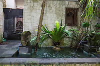Bali, Indonesia.  Fountain and Pool at Entrance to Private Home.  Ganesh Sculpture in Left Background.