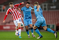 21st April 2021; Bet365 Stadium, Stoke, Staffordshire, England; English Football League Championship Football, Stoke City versus Coventry; Nick Powell of Stoke City is tackled by Matty James of Coventry City