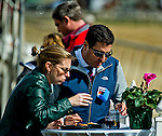 LAUREL, MARYLAND - OCTOBER 22: Fans handicap races on Maryland Million Day at Laurel Park on October 22, 2016 in Laurel, Maryland. (Photo by Scott Serio/Eclipse Sportswire/Getty Images)