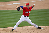 Round Rock Express pitcher Jeff Beliveau #57 delivers a pitch to the plate against the Omaha Storm Chasers in the Pacific Coast League baseball game on April 7, 2013 at the Dell Diamond in Round Rock, Texas. Omaha beat Round Rock 5-2, handing the Express their first loss of the season. (Andrew Woolley/Four Seam Images).