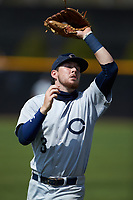 Catawba Indians shortstop Jeremy Simpson (3) catches a pop fly during game two of a double-header against the Queens Royals at Tuckaseegee Dream Fields on March 26, 2021 in Kannapolis, North Carolina. (Brian Westerholt/Four Seam Images)