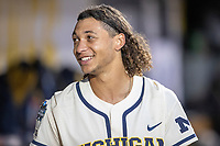 Michigan Wolverines outfielder Jordan Brewer (22) in the dugout against the Vanderbilt Commodores during Game 1 of the NCAA College World Series Finals on June 24, 2019 at TD Ameritrade Park in Omaha, Nebraska. Michigan defeated Vanderbilt 7-4. (Andrew Woolley/Four Seam Images)