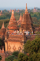 Myanmar, Burma, Bagan.  Temples provide good vantage points for tourists to watch the sunrise.