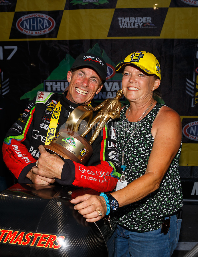 Jun 18, 2017; Bristol, TN, USA; NHRA top fuel driver Clay Millican celebrates with wife Donna Millican after winning the Thunder Valley Nationals at Bristol Dragway. Mandatory Credit: Mark J. Rebilas-USA TODAY Sports