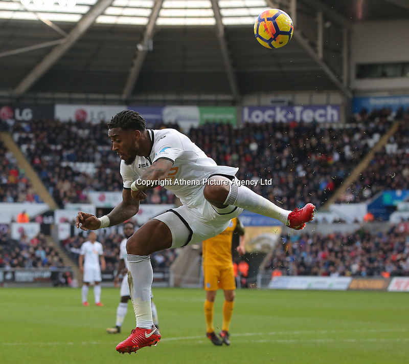Leroy Fer of Swansea City keeps the ball in play during the Premier League match between Swansea City and Brighton and Hove Albion at The Liberty Stadium, Swansea, Wales, UK. Saturday 04 November 2017
