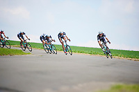 Andrew Fenn (GBR/OPQS) stearing into a highspeed corner with his teammates in tow<br /> <br /> 2014 Belgium Tour<br /> (final) stage 5: Oreye - Oreye (179km)
