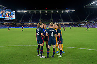 ORLANDO, FL - FEBRUARY 24: Tierna Davidson #12 , Casey Krueger #2, Becky Sauerbrunn #4, Jane Campbell #18 and Kelley O'Hara #5 of the USWNT huddle before a game between Argentina and USWNT at Exploria Stadium on February 24, 2021 in Orlando, Florida.