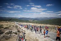 peloton coming through at 1800m<br /> <br /> stage 20: San Lorenzo de el Escorial - Cercedilla (176km)<br /> 2015 Vuelta à Espana