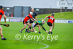 Referee Mike Sexton watches as Lixnaw's Mikey Kelliher takes possession as Ballyheigue's Ricky Hussey and Jordan Goggin bares down on him, in Round 2 of the County Senior Hurling championship,