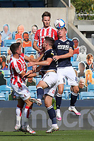 Nick Powell of Stoke City heads the ball into the Millwall penalty area under pressure from Shaun Williams during Millwall vs Stoke City, Sky Bet EFL Championship Football at The Den on 12th September 2020