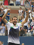 Marin Cilic (CRO) defeats Roger Federer (SUI) in the semifinals 6-3, 6-4, 6-4 at the US Open being played at USTA Billie Jean King National Tennis Center in Flushing, NY on September 6, 2014