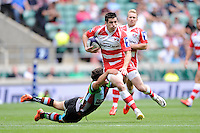 Rhodri McAtee of Gloucester Rugby 7s is tackled by Jordan Burns of Harlequins 7s during the World Club 7s at Twickenham on Sunday 18th August 2013 (Photo by Rob Munro)