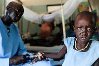 SOUTH SUDAN  Bahr al Ghazal region , Lakes State, hospital of Comboni Missionaries in village Mapuordit, children are treated of malaria / SUED-SUDAN  Bahr el Ghazal region , Lakes State, Mary Immaculate DOR Hospital der Comboni Missionare im Dinka Dorf Mapuordit , Maedchen wird wegen Malaria behandelt