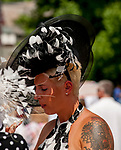 SARATOGA SPRINGS, NY - AUGUST 25: A woman wears a black and white feathered fascinator on Travers Stakes Day at Saratoga Race Course on August 25, 2018 in Saratoga Springs, New York. (Photo by Carson Dennis/Eclipse Sportswire/Getty Images)