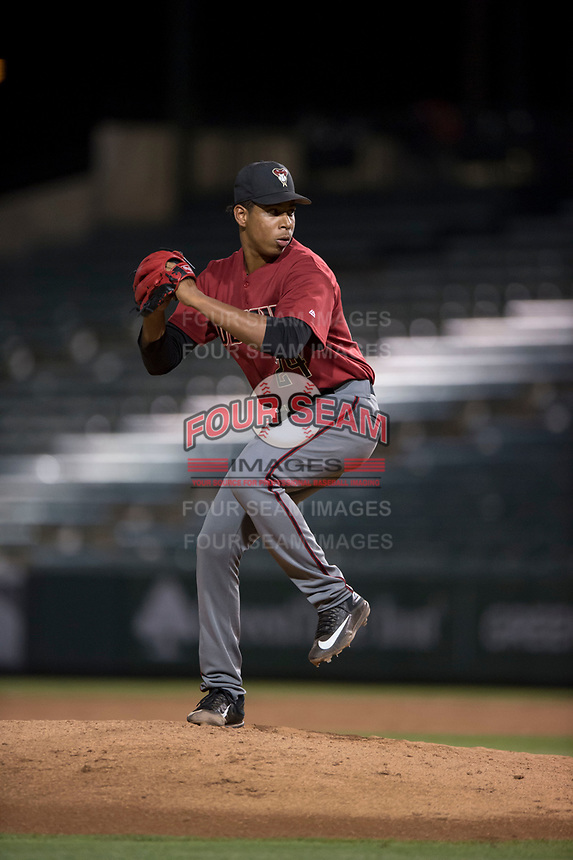 AZL Diamondbacks relief pitcher Raibel Custodio (24) delivers a pitch during an Arizona League game against the AZL Angels at Tempe Diablo Stadium on June 27, 2018 in Tempe, Arizona. The AZL Angels defeated the AZL Diamondbacks 5-3. (Zachary Lucy/Four Seam Images)