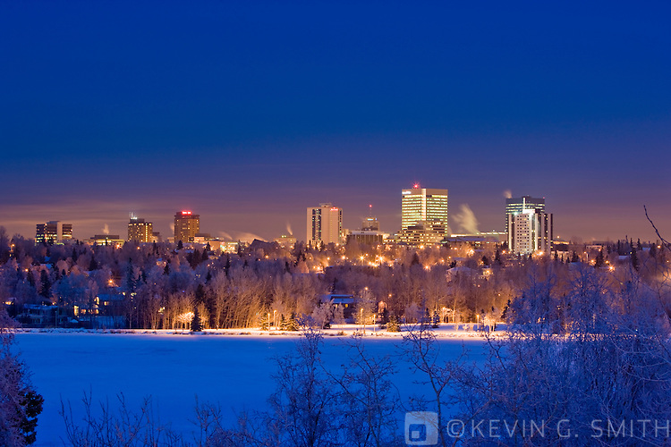 The Anchorage skyline at twilight,  Westchester Lagoon in the foreground, winter, Anchorage, Southcentral Alaska, USA.